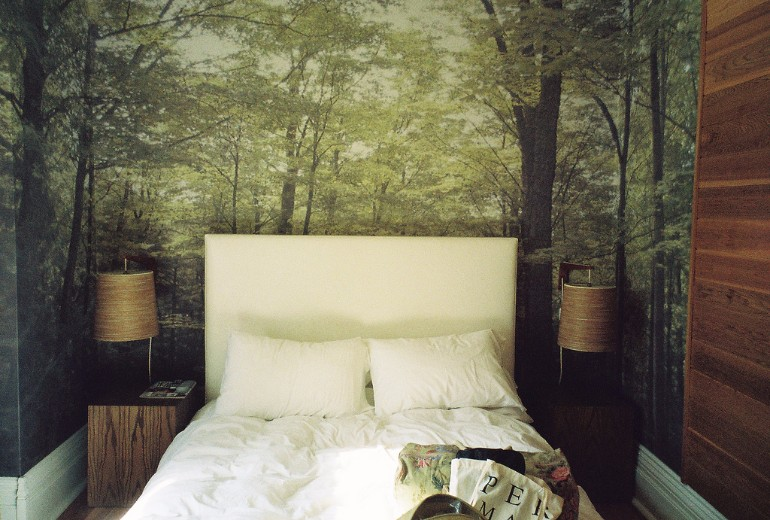whimsical master bedrooms with forest wallpaper master