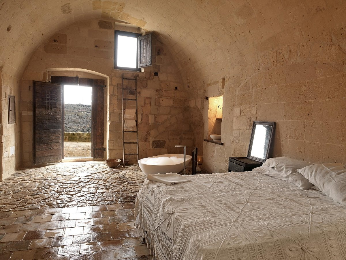 dream bedroom Dream bedrooms from all around the world Pt II Sextantio le grotte della civita ancient cave fabulous stone bedroom simple furnishes sophisticated rustic bedroom decor
