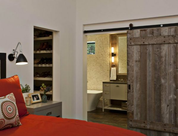 bedrooms 10 Splendid Bedrooms With Wooden Sliding Doors home design amazing dark wood sliding barn door with wall shelves and red lunge chair plus wood cabinet also reading lamp for interior design ideas fascinating sliding barn door 600x460