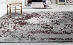 10 Luxury Rugs For An Imposing Master Bedroom luxury rug 10 Luxury Rugs For An Imposing Master Bedroom posidon rug emporium chair 1 240x150