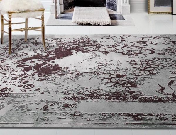 10 Luxury Rugs For An Imposing Master Bedroom luxury rug 10 Luxury Rugs For An Imposing Master Bedroom posidon rug emporium chair 1 600x460